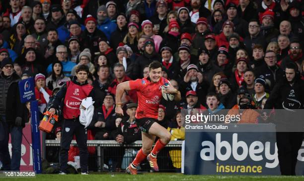 Jacob Stockdale of Ulster on his way to scoring his second try during the Champions Cup match between Ulster Rugby and Racing 92 at Kingspan Stadium...