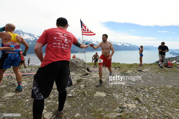 Jacob Streich gets a drink as he passes the top of Mount Marathon during the Men's Division of the 91st Running of the Mount Marathon Race on July 4...
