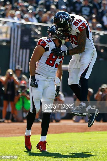 Jacob Tamme of the Atlanta Falcons celebrates with Levine Toilolo after a 14-yard catch for a touchdown against the Oakland Raiders during their NFL...