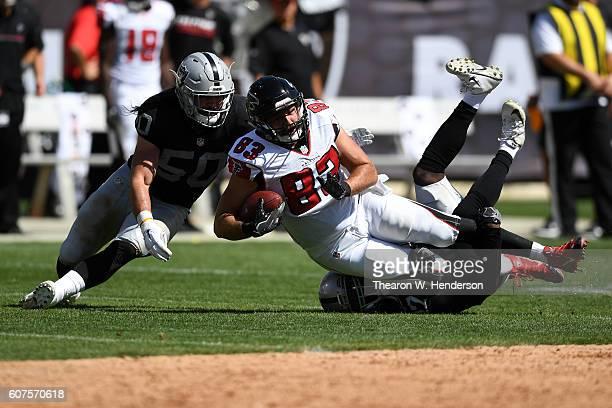 Jacob Tamme of the Atlanta Falcons is tackled after a catch against the Oakland Raiders during their NFL game at Oakland-Alameda County Coliseum on...