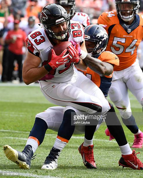 Jacob Tamme of the Atlanta Falcons is tackled by Todd Davis of the Denver Broncos during the first quarter. The Denver Broncos hosted the Atlanta...
