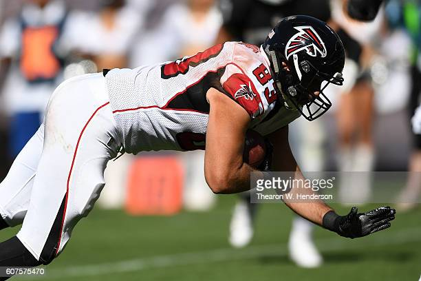 Jacob Tamme of the Atlanta Falcons makes a 14-yard catch for a touchdown against the Oakland Raiders during their NFL game at Oakland-Alameda County...