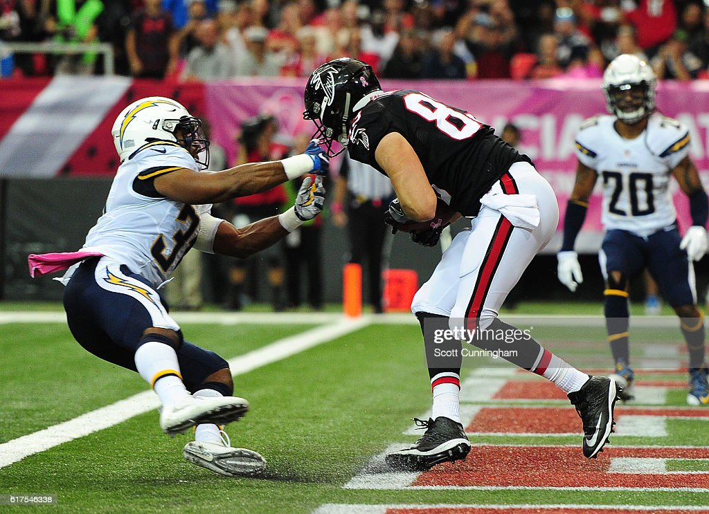 Jacob Tamme #83 of the Atlanta Falcons makes a catch for a touchdown against Adrian Phillips #31 of the San Diego Chargers at the Georgia Dome on October 23, 2016 in Atlanta, Georgia.