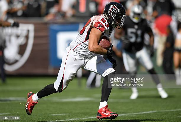 Jacob Tamme of the Atlanta Falcons runs towards the endzone for a touchdown against the Oakland Raiders during the second half of their NFL game at...