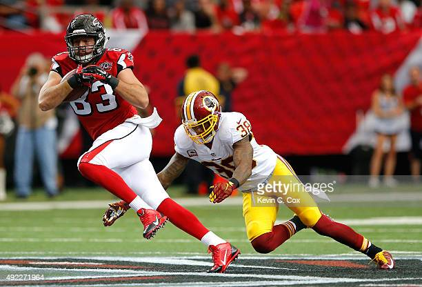 Jacob Tamme of the Atlanta Falcons rushes away from Dashon Goldson of the Washington Redskins at Georgia Dome on October 11, 2015 in Atlanta, Georgia.
