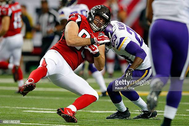 Jacob Tamme of the Atlanta Falcons spins away from Andrew Sendejo of the Minnesota Vikings after a catch during the first half at the Georgia Dome on...