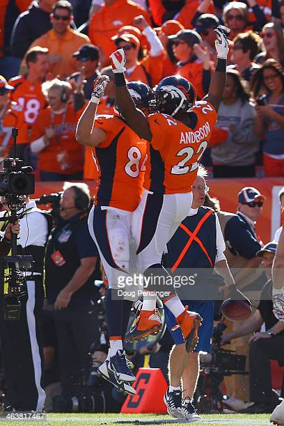 Jacob Tamme of the Denver Broncos celebrates his second quarter touchdown against the New England Patriots with C.J. Anderson during the AFC...
