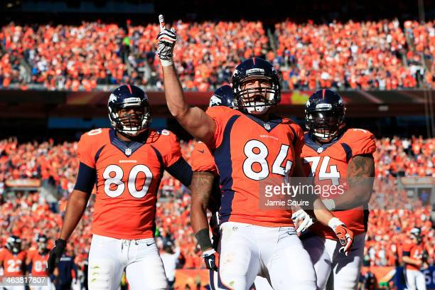 Jacob Tamme of the Denver Broncos celebrates his second quarter touchdown with teammates during the AFC Championship game against the New England...