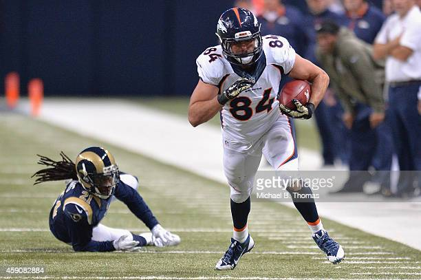 Jacob Tamme of the Denver Broncos rushes after a catch against the St Louis Rams at the Edward Jones Dome on November 16 2014 in St Louis Missouri...