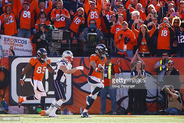 Jacob Tamme of the Denver Broncos scores a second quarter touchdown against the New England Patriots during the AFC Championship game at Sports...