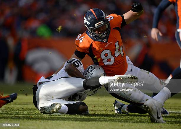 Jacob Tamme of the Denver Broncos tackles Kenbrell Thompkins of the Oakland Raiders on a kick return in the first quarter. The Denver Broncos played...