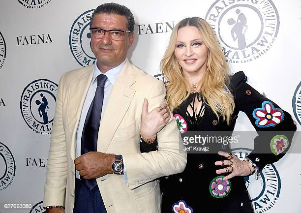 Jacob The Jeweler and Madonna attend Madonna Presents An Evening of Music Art Mischief and Performance to Benefit Raising Malawi at Faena Forum on...