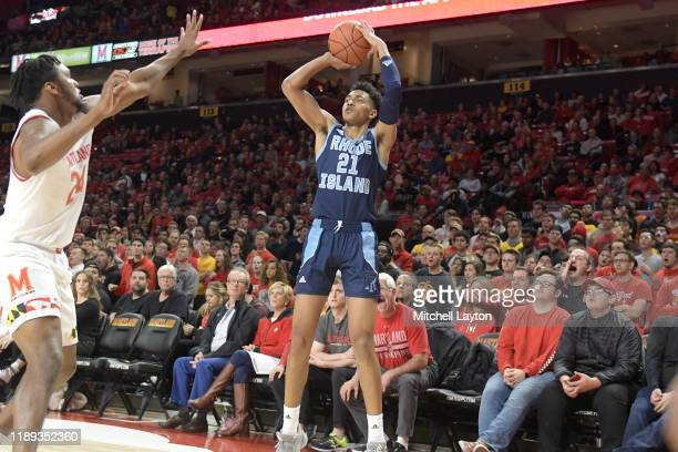 Jacob Toppin of the Rhode Island Rams takes a jump shot during a basketball game against the Maryland Terrapins at the Xfinity Center on November 9...
