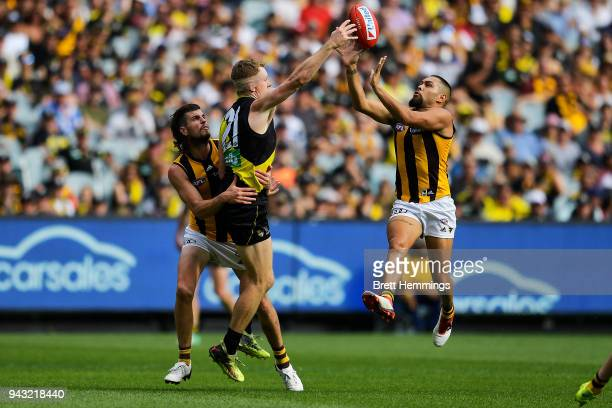 Jacob Townsend of the Tigers and Jarman Impey of the Hawks contest the ball during the round three AFL match between the Richmond Tigers and the...