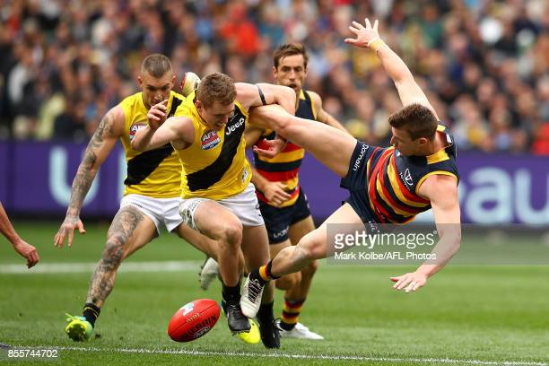 Jacob Townsend of the Tigers tackles Josh Jenkins of the Crows as they compete for the ball during the 2017 AFL Grand Final match between the...