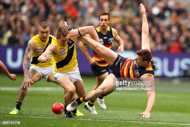 Jacob Townsend of the Tigers tackles Josh Jenkins of the Crows as the compete for the ball during the 2017 AFL Grand Final match between the Adelaide...
