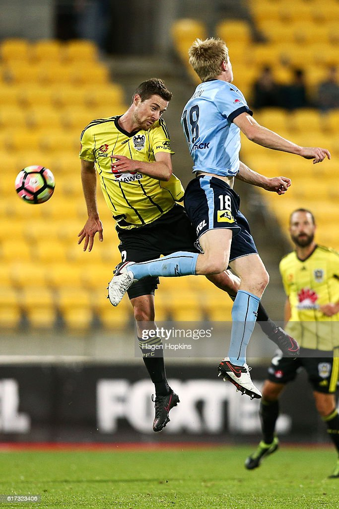 Jacob Tratt of the Phoenix and Matt Simon of Sydney FC compete for a header during the round three A-League match between the Wellington Phoenix and Sydney FC at Westpac Stadium on October 23, 2016 in Wellington, New Zealand.