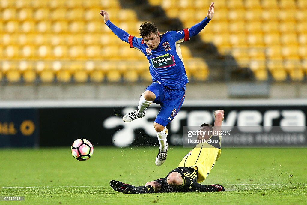 Jacob Tratt of the Phoenix tackles Wayne Brown of the Jets during the round five A-League match between the Wellington Phoenix and the Newcastle Jets at Westpac Stadium on November 5, 2016 in Wellington, New Zealand.