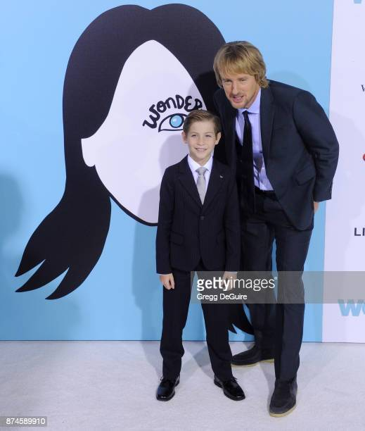 Jacob Tremblay and Owen Wilson arrive at the premiere of Lionsgate's Wonder at Regency Village Theatre on November 14 2017 in Westwood California