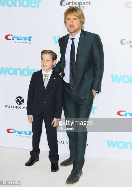 Jacob Tremblay and Owen Wilson attend the premiere of Lionsgate's 'Wonder' on November 14 2017 in Los Angeles California