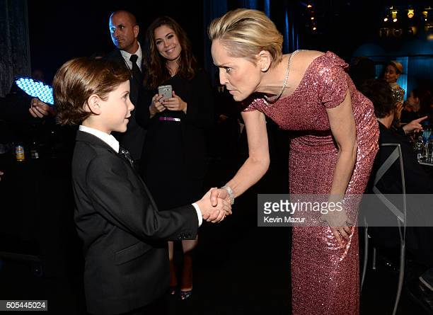 Jacob Tremblay and Sharon Stone attend the 21st Annual Critics' Choice Awards at Barker Hangar on January 17 2016 in Santa Monica California