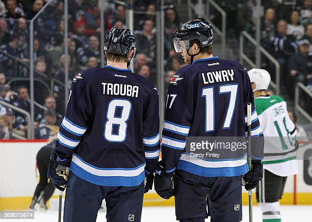 Jacob Trouba and Adam Lowry of the Winnipeg Jets discuss strategy during a first period stoppage in play against the Dallas Stars at the MTS Centre...