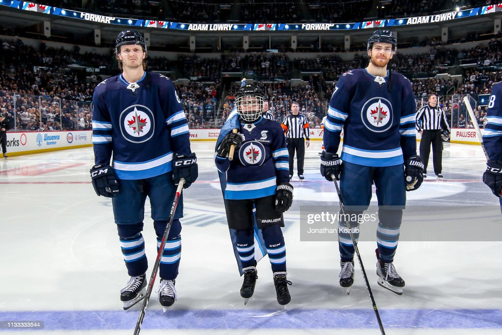 Jacob Trouba And Adam Lowry Of The Winnipeg Jets Pose With The News Photo Getty Images