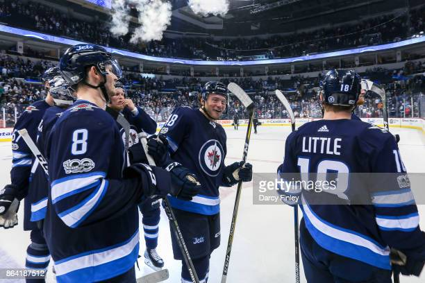 Jacob Trouba Brendan Lemieux and Bryan Little of the Winnipeg Jets celebrate following a 43 victory over the Minnesota Wild at the Bell MTS Place on...