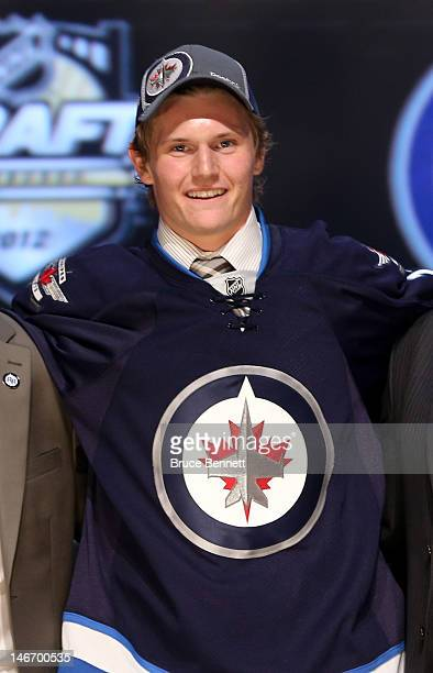 Jacob Trouba, ninth overall pick by the Winnipeg Jets, poses on stage during Round One of the 2012 NHL Entry Draft at Consol Energy Center on June...