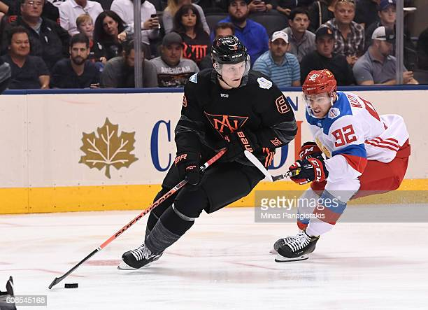 Jacob Trouba of Team North America stickhandles the puck with pressure from Evgeny Kuznetsov of Team Russia during the World Cup of Hockey 2016 at...