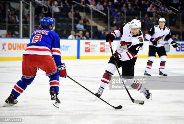 Jacob Trouba of the New York Rangers attempts to block Carl Soderberg's of the Arizona Coyotes shot during the third period of their game at Madison...