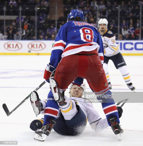Jacob Trouba of the New York Rangers steps into Sam Reinhart of the Buffalo Sabres during the third period at Madison Square Garden on October 24,...