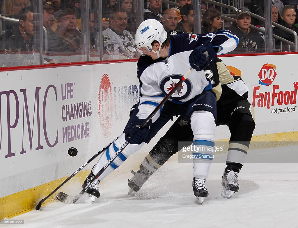 Jacob Trouba #8 of the Winnipeg Jets battles for the puck during the third period against the Pittsburgh Penguins at Consol Energy Center on January 27, 2015 in Pittsburgh, Pennsylvania.
