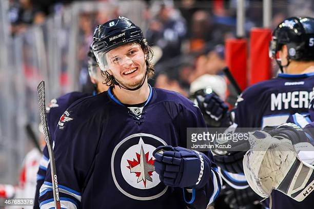 Jacob Trouba of the Winnipeg Jets celebrates a first period goal against the Washington Capitals with teammates at the bench on March 21 2015 at the...