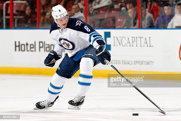 Jacob Trouba of the Winnipeg Jets controls the puck against the Florida Panthers at the BBT Center on December 5 2013 in Sunrise Florida