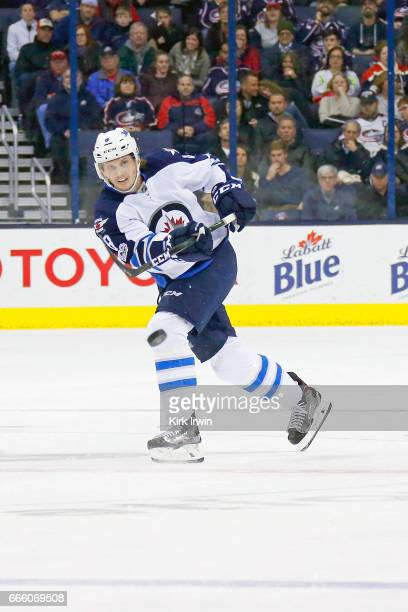 Jacob Trouba of the Winnipeg Jets controls the puck during the game against the Columbus Blue Jackets on April 6 2017 at Nationwide Arena in Columbus...