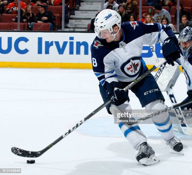 Jacob Trouba of the Winnipeg Jets controls the puck during the game against the Anaheim Ducks on January 25 2018 at Honda Center in Anaheim California