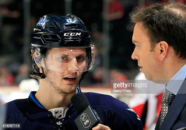Jacob Trouba of the Winnipeg Jets does an pregame interview with Sportsnet reporter Elliotte Friedman prior to NHL action against the Ottawa Senators...