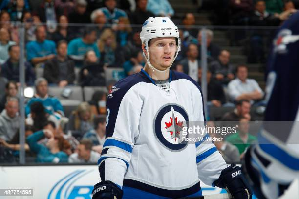 Jacob Trouba of the Winnipeg Jets during a break in play against the San Jose Sharks at SAP Center on March 27 2014 in San Jose California