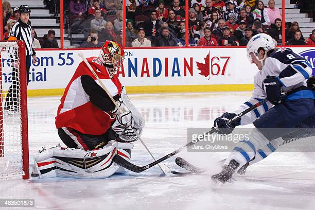 Jacob Trouba of the Winnipeg Jets earns an assist as he watches the puck go in the net past Craig Anderson of the Ottawa Senators in the second...
