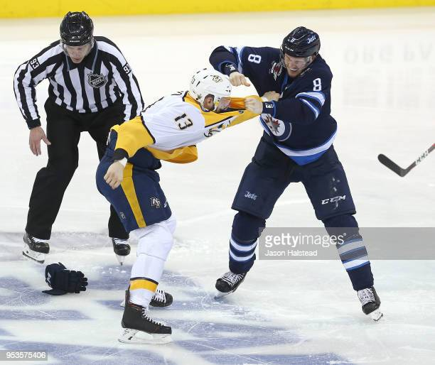 Jacob Trouba of the Winnipeg Jets fights Nick Bonino of the Nashville Predators in Game Three of the Western Conference Second Round during the 2018...