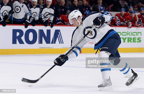 Jacob Trouba of the Winnipeg Jets fires a slap shot against the Montreal Canadiens during the NHL game on February 2 2014 at the Bell Centre in...