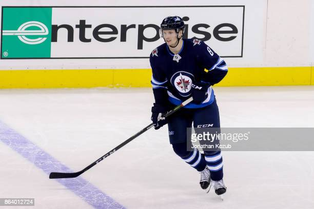 Jacob Trouba of the Winnipeg Jets follows play down the ice during third period action against the Carolina Hurricanes at the Bell MTS Place on...