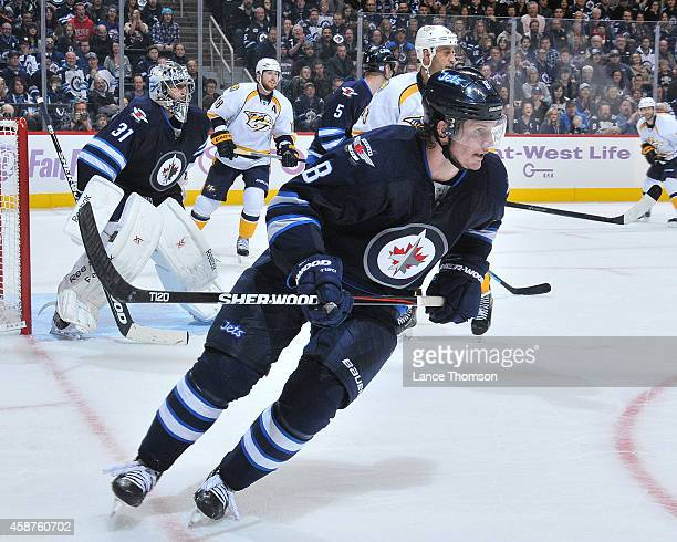 Jacob Trouba of the Winnipeg Jets follows the play around the boards during third period action against the Nashville Predators on November 4 2014 at...