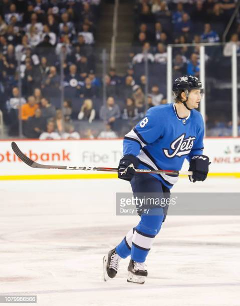 Jacob Trouba of the Winnipeg Jets follows the play down the ice during first period action against the St Louis Blues at the Bell MTS Place on...