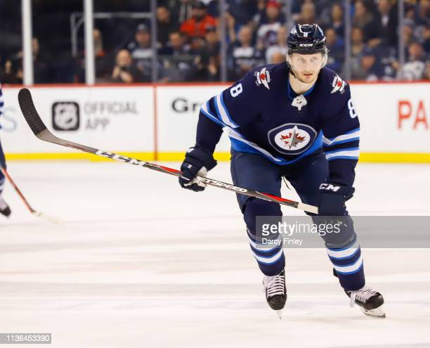 Jacob Trouba of the Winnipeg Jets follows the play down the ice during second period action against the Boston Bruins at the Bell MTS Place on March...