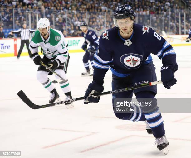 Jacob Trouba of the Winnipeg Jets follows the play down the ice during third period action against the Dallas Stars at the Bell MTS Place on November...