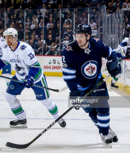 Jacob Trouba of the Winnipeg Jets follows the play down the ice during first period action against the Vancouver Canucks at the Bell MTS Place on...