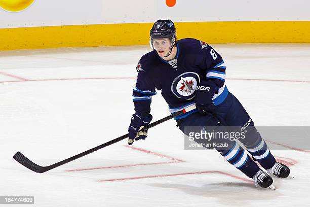 Jacob Trouba of the Winnipeg Jets follows the play up the ice during first period action against the Dallas Stars at the MTS Centre on October 11...