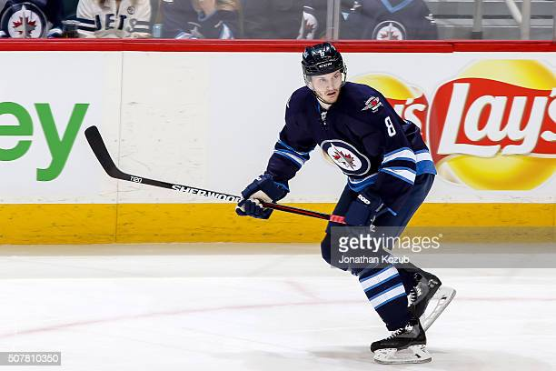 Jacob Trouba of the Winnipeg Jets follows the play up the ice during first period action against the Arizona Coyotes at the MTS Centre on January 26...
